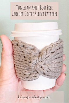 Looking for a stylish eco-friendly alternative to the paper coffee sleeve? Look no further than my Tunisian Knit Bow Coffee Sleeve pattern. This FREE easy crochet pattern is perfect for the eager beginner wanting to try Tunisian Crochet. Plus it uses a regular 10mm crochet hook and only 1/2 an ounce of Bernat Maker Home Dec Yarn. Fits any size coffee cup (from 8oz to 20oz).