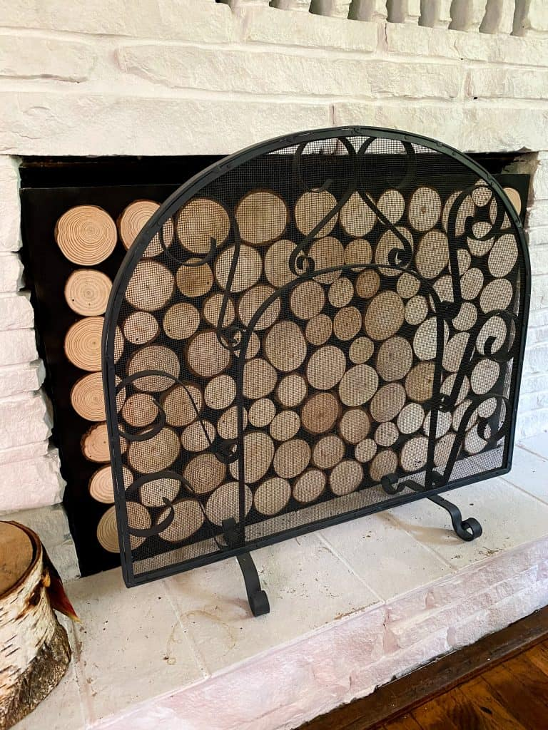 How to make this easy stacked wood looking fireplace you've seen in all the design magazines! Perfect for baby proofing tour fireplace.
