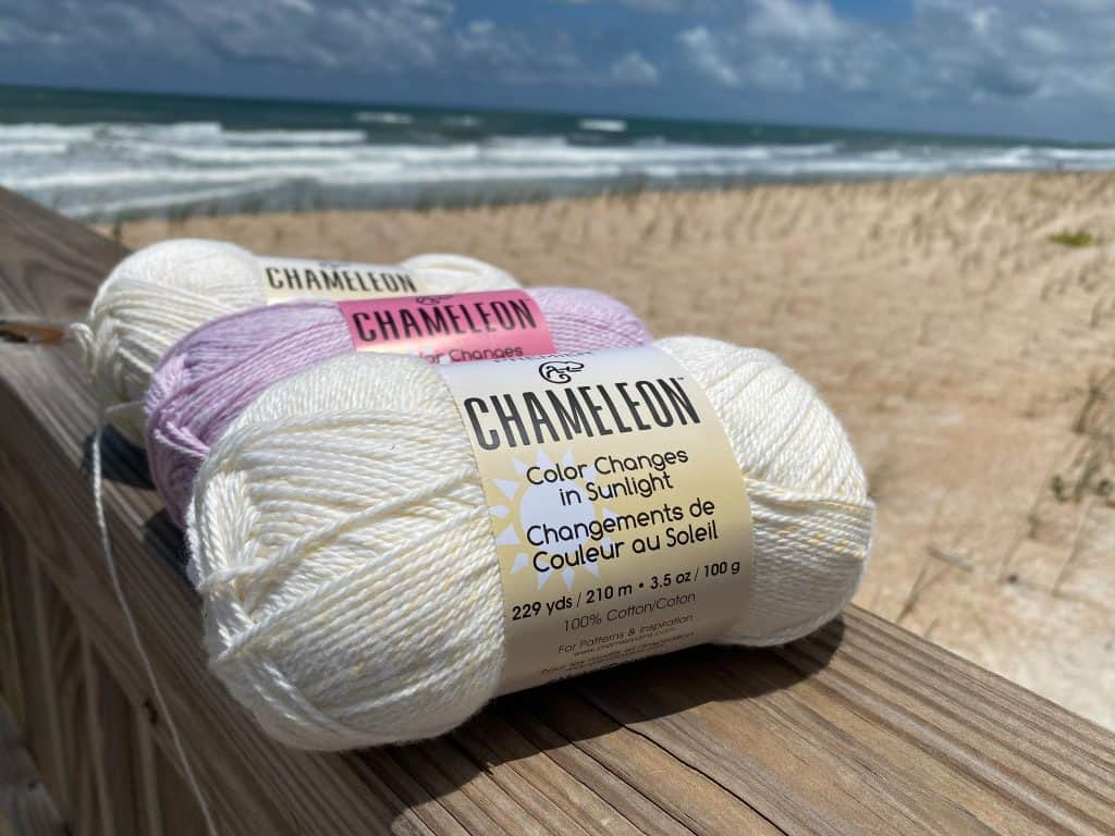 If you've been into Michaels lately you've probably seen this summer's hottest new yarn product... Premier Yarns Chameleon. This yarn is 100% cotton and changes from white to a variety of different colors in the sunlight. But at $7.99 for only 3.5 oz you have to wonder is it really worth it... I recently bought three skeins and put it to the test and wanted to share my opinion with all you fellow yarn lovers.