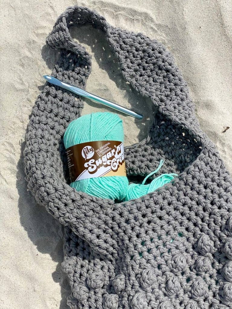 The Bobble Hobo Bag FREE Crochet Pattern. Using 2 strands of Lily Sugar n' Cream at once. You'll have this perfect summer bag done in no time and ready for your next adventure!